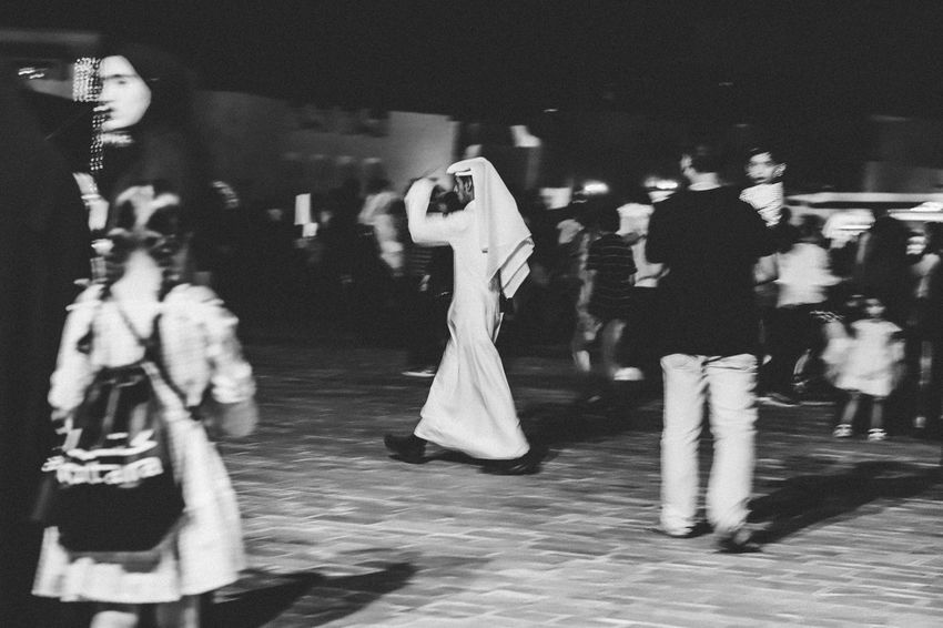 Salaam One Man Qatar Arabian Man Thobe Blackandwhite Walking Human Representation Representation Art And Craft Group Of People Male Likeness Female Likeness Creativity People Architecture Arts Culture And Entertainment Full Length Men Real People Built Structure Clothing Outdoors The Still Life Photographer - 2018 EyeEm Awards