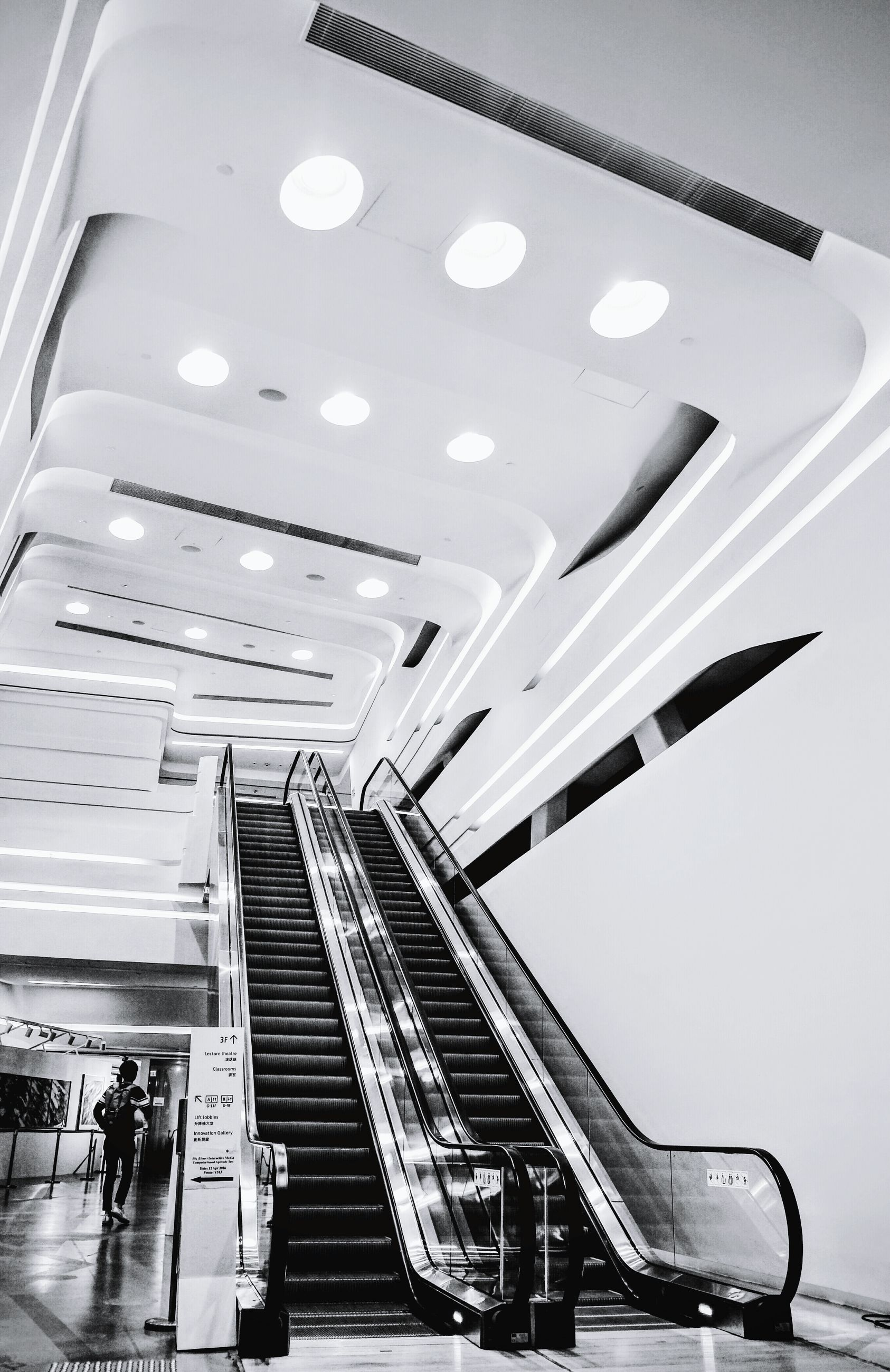 indoors, steps, steps and staircases, staircase, ceiling, technology, high angle view, escalator, low angle view, modern, transportation, railing, convenience, built structure, architecture, in a row, no people, arts culture and entertainment, metal, incidental people