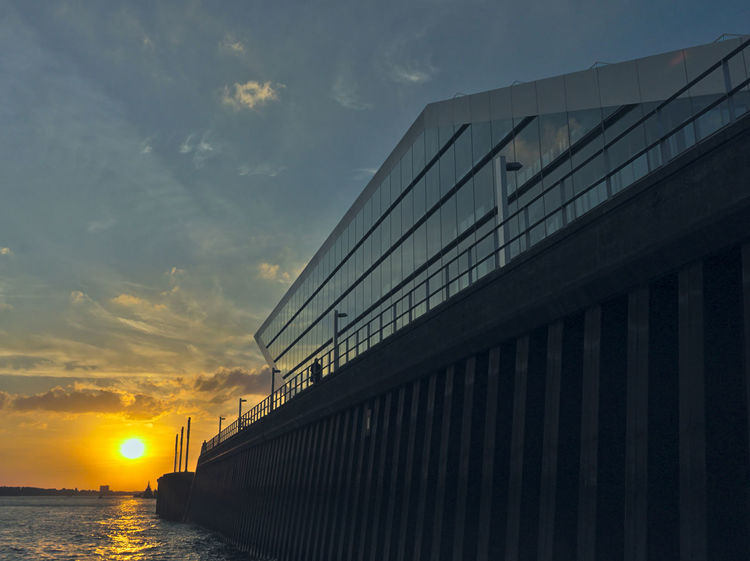 """""""The Wedge"""" - Downstream view at """"Dockland"""" during sunset - Hamburg, Germany Cityscape Dockland Elbe River Hamburg Harbor Architecture Building Built Structure Cloud - Sky Dusk Evening Low Angle View Office Building Orange Color Reflection Sky Sun Sunlight Sunset Water"""