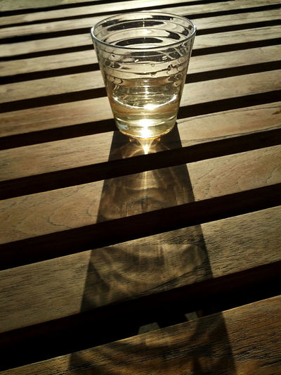 43 Golden Moments Aperitive Backlit Diagonal Lines Glass Illuminated No People Sunlight Sunset Wooden Table