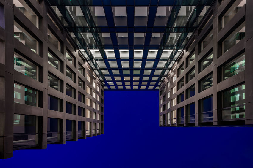 Office building in Blaak district in Rotterdam. Shot during blue hour. Rotterdam The Architect - 2018 EyeEm Awards Architecture Blue Building Building Exterior Built Structure City Low Angle View No People Window