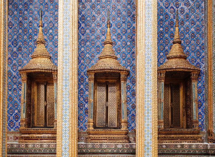 Artisan ceramic facade and window of bangkok grand palace - wat phra kaew - emerald buddha temple