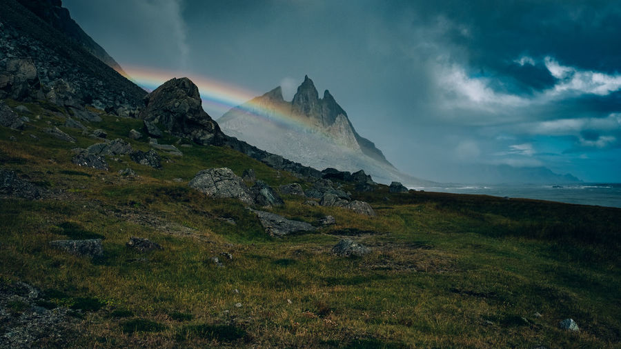Shot on a hiking path on the Stokksnes promontory in East Iceland. Green Hiking Iceland Nature Stokksnes Beauty In Nature Cloud - Sky Day Grass Landscape Mountain Nature No People Outdoors Rainbow Rocks Scenics Sky Tranquil Scene Tranquility Vestrahorn Water Weed