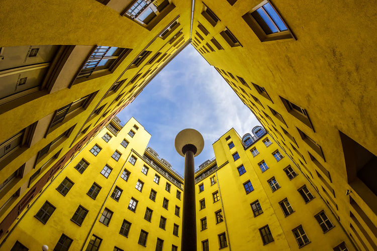 yellow facade Berlin Façade Light Lines Yellow Flower Architecture Building Exterior Built Structure City Colour Day Fassade Lamp Light And Shadow Low Angle View No People Outdoors Sky Symmetry Window Yellow