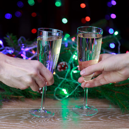 Champagne Toast Christmas Eve Christmas Christmas Party New Year Celebratory Toast Beverage Cheers Bubbly Wine Christmas Is Coming Christmas Around The World Christmas Spirit Night Lights Night Alcohol Holding Drink Human Hand Christmas Lights Mery Christmas Bokeh Effect Bokeh Celebration