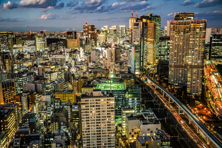 High angle view of illuminated buildings in city against sky