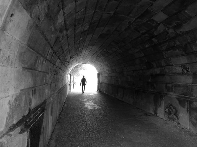 Monochrome Photography Coming Tunnel Arch Indoors  Architecture Built Structure Walking Wall - Building Feature Full Length Light At The End Of The Tunnel Silhouette The Way Forward Pedestrian Walkway Light At The End Of Tunnel Day Archway Stone Material