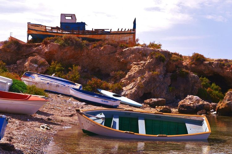 Boats Boat Beach Tranquility Place Of Interest Beach Photography Beach Life Alicante, Spain Tabarca Island Life Island Tranquility Scene Place Tabarca's Island Alicante Islandlife Relaxing Sea Reflection Town Fisherman Tied Boat Relaxing Beachphotography TOWNSCAPE