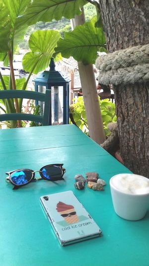 My Favorite Place No People Coffee Table Coffee Cup Cappuccino Fashionphotography Close-up High Angle View Sunglasses Breakfast Morning Relaxing Holiday Taking Photos Outdoors