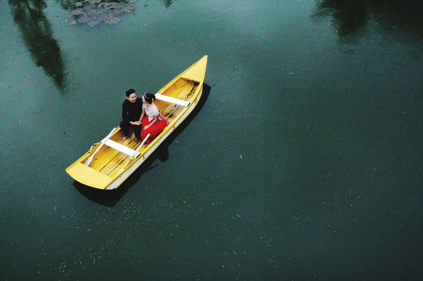 Nautical Vessel Transportation Floating On Water High Angle View Fisherman Fishing Fishing Net Water Lake Rowing Outdoors Men Adult People Oar Day Women Kayak Nature Occupation Paint The Town Yellow