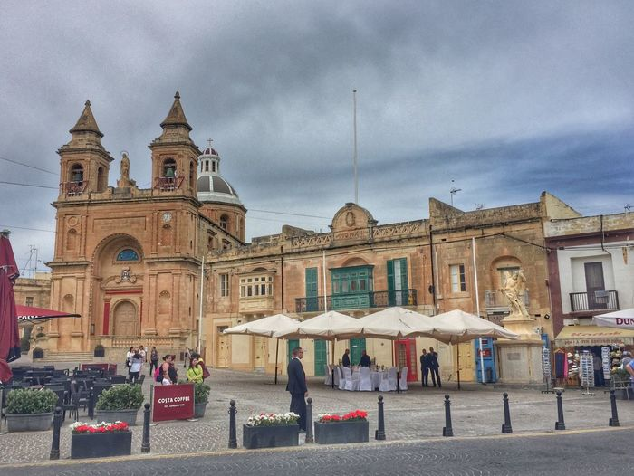 Old church and historical building in Marsaxlokk in Malta Architecture Building Exterior Built Structure Church City Cloud - Sky Day History Large Group Of People Outdoors People Place Of Worship Real People Religion Sky Spirituality Tourism Travel Travel Destinations
