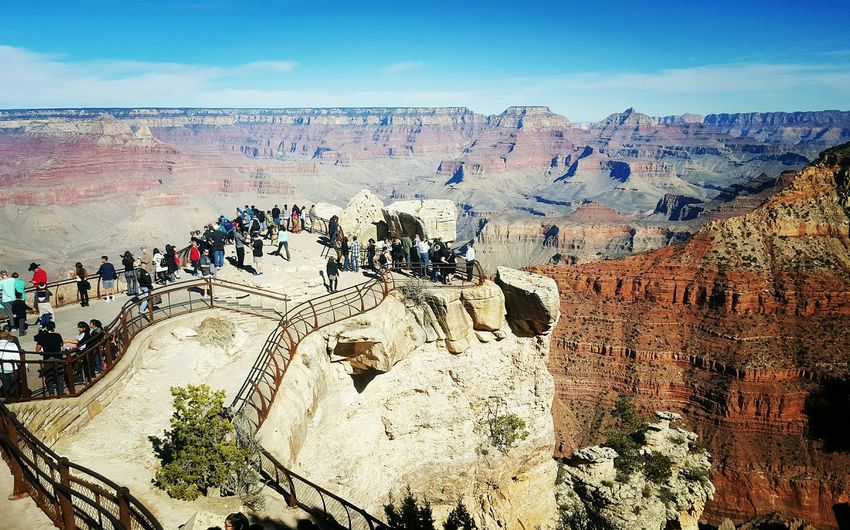 Tourists At Observation Point By Rocky Mountains At Grand Canyon National Park