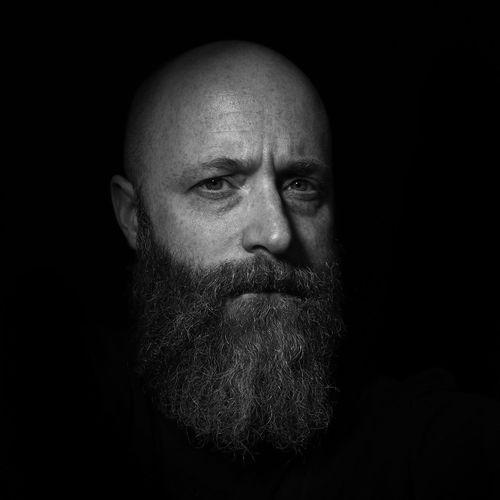 Dark Me Dark Bearded Beard Portrait Studio Shot Close-up Headshot Indoors  Front View Black Background Mid Adult Men Shaved Head Adult Mature Men