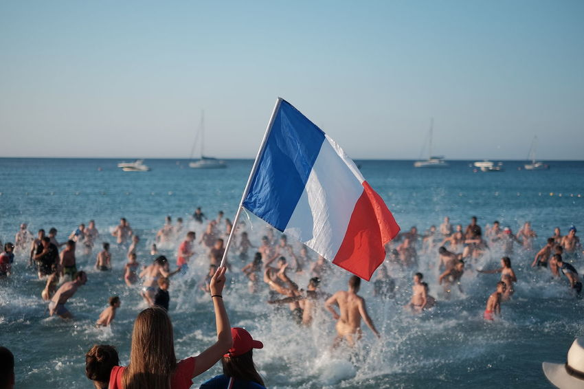 Celebrating in Water Football France Adult Beach Clear Sky Crowd Day Flag Group Of People Horizon Over Water Land Large Group Of People Leisure Activity Lifestyles Men Nature Outdoors Real People Sea Sky Water Women world cup 2018