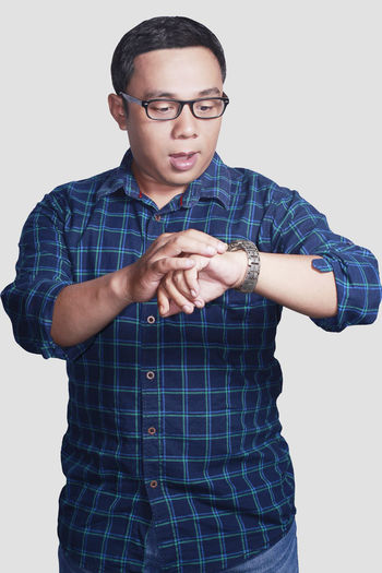 portrait of asian young man late for work concept Eyeglasses  Adult One Person Men Young Adult White Background Work Clock Hour Hand Time Eyeglasses  Late Lifestyles