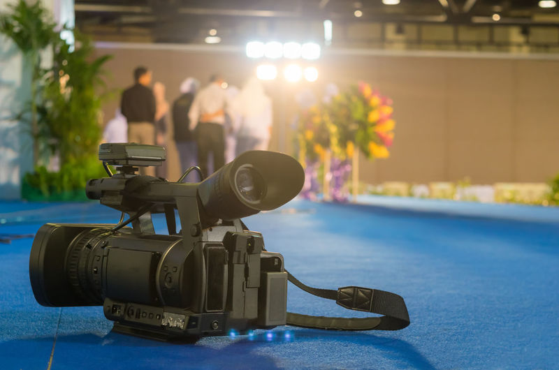 Close-up of home video camera on table at wedding