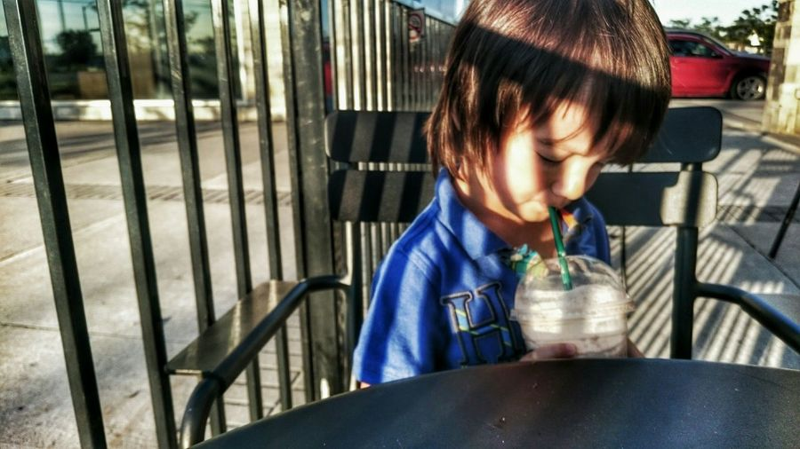Close-up of boy drinking outdoors