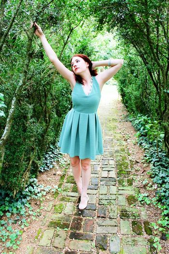 Gen Brock Path Arms Outstretched Beauty Casual Clothing Day Dress Enjoyment Front View Full Length Fun Leisure Activity Lifestyles Long Hair Outdoors Person Portrait Sensuality Tree Young Adult Young Women