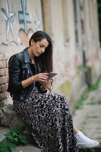 Young woman using mobile phone outdoors