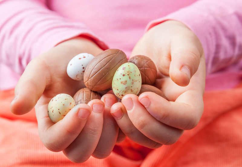 Child's hands holding chocolate Easter eggs. Chocolate Easter Easter Eggs Sugar Sugar Coated Childhood Close-up Closeup Day Focus On Foreground Food Food And Drink Fragility Freshness Happy Easter Holding Human Body Part Human Hand Nature Nut - Food One Person Outdoors People Real People