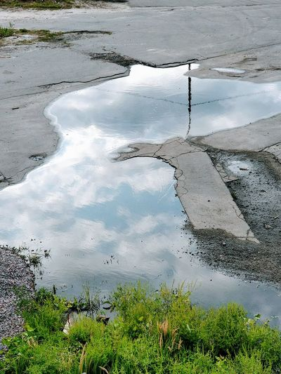 Water Nature Outdoors High Angle View Day No People Beauty In Nature Puddle Kiev Ukraine City Travel Destinations Reflection Cloud - Sky Pavement Concrete Perspectives On Nature
