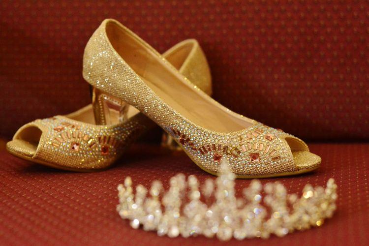 Close-up of high heels and tiara