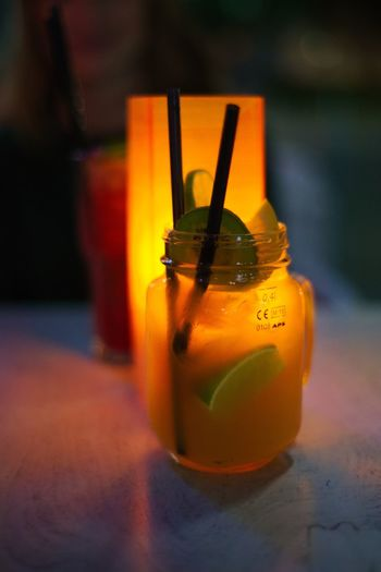 """A """"stay tuned"""" cocktail at the bar Mauritius in Esslingen. Cocktail Drinks Glasses Happy Hour Backlit Citrus Fruit Close-up Cocktails Cold Drink Evening Focus On Foreground Food Food And Drink Freshness Glass Indoors  Lime Orange Color Shugar Straw Sweet Table Tables Yellow"""