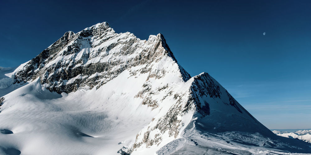 Jungfrau Snow Winter Cold Temperature Mountain Extreme Weather Mountain Peak Formation Outdoors White Color Clear Sky Mountain Range Snowcapped Mountain Moon