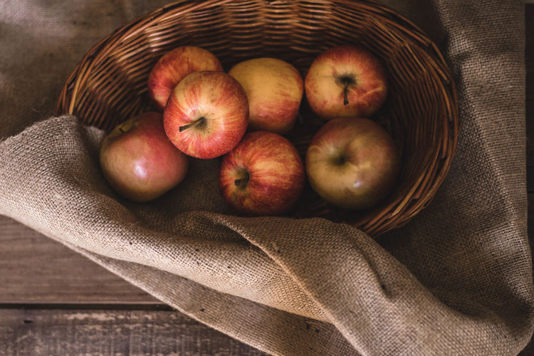 High angle view of apples in basket on table