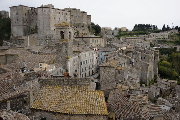 view of the roofs of Sorano, Tuscany Architecture Building Exterior Built Structure Building Nature History City High Angle View Day Residential District The Past Sky Town Old No People Outdoors Clear Sky House Ancient Tree Ancient Civilization