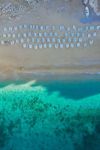 A small hidden beach located below a winding road near Kas, Turkey. Week On Eyeem Aerial View Dji Mavic Pro 2 Turkey Drone Photography Beach Ocean Underwater Turquoise Colored Sea Water Nature Beauty In Nature High Angle View Pool Sand Marine Drone  Outdoors Day