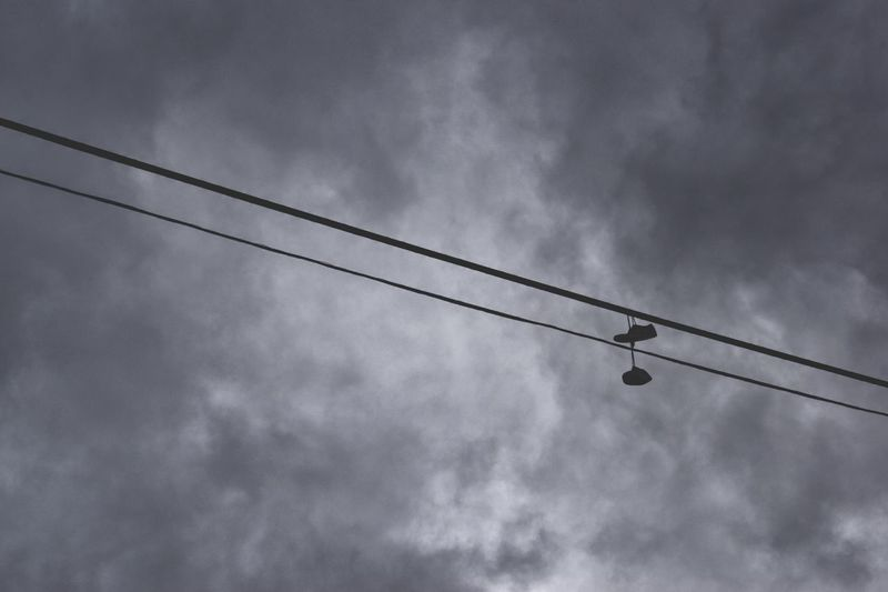 "Pretty Noose / SoundGarden ⬛️ ""... and i don't like what you got me hangin from..."" ⬛️ nike, air 😆😂😆 Blackandwhite Abandoned Suspeneded Hanging Shoes Low Angle View Cable Sky Cloud - Sky Silhouette No People Power Line  Connection Day Nature Outdoors"