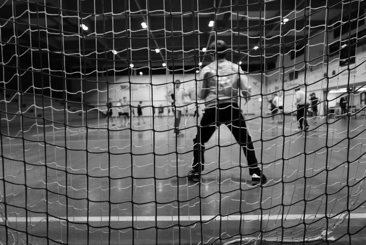 Indoors  Sport Black And White Competition Activity Play Ball Handball Behind Goal Net Full Frame