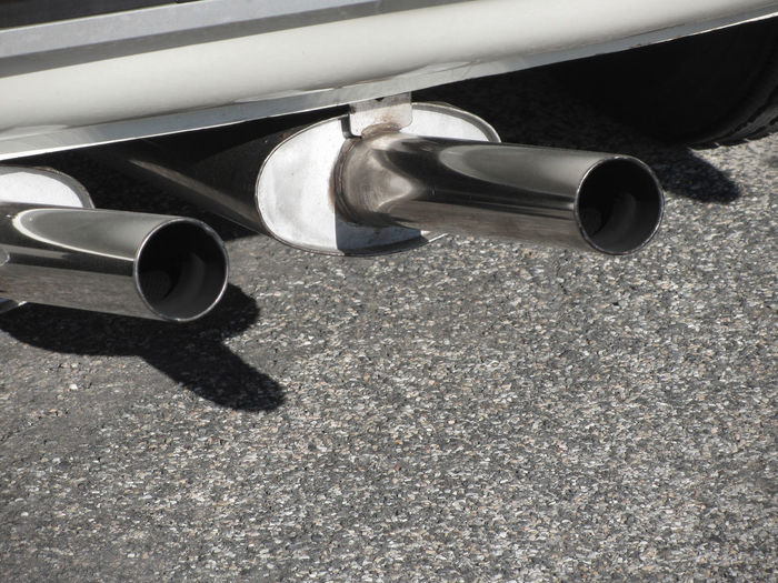 Closeup of a classic car exhaust pipe . Double pipe . Pollution concept Auto Automobile Blowing Car Chrome Co2 Combustion Detail Dioxide Double Dust Environment Exhaust Exhaust Pipe Fumes Monoxide Particle Pipe Pollutant Emission Pollution Power Smoke Tail Tailpipe Toxic