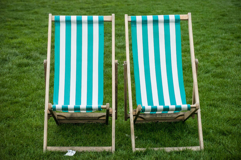 Two empty beach chairs in Hyde Park, London Absence Beach Chair Chair Day Empty Field Grass Green Color Lounge Chair Outdoors Relaxation Seat Striped Pattern