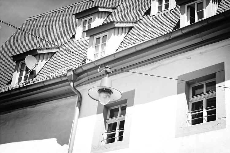 Close-up of high section of rooftops against clear sky