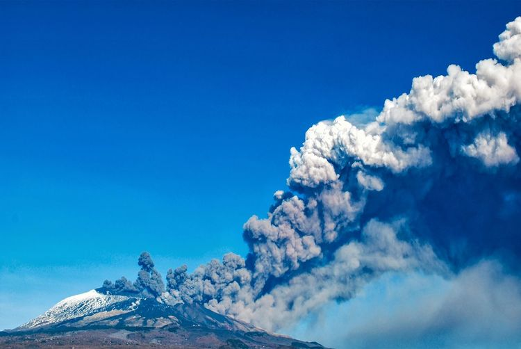 Etna's eruption ...December 24th, 2018 Etna Mountain Volcano Eruption Day Sudden Explosion Gas Sicily Lava Italy Etna, Mountain, Sicily, December 2018 Hearthquake Impression Nature Vulcanology No People Blue Smoke Ash Events Geophisics Blue Mountain Sky Snow Covered Cold