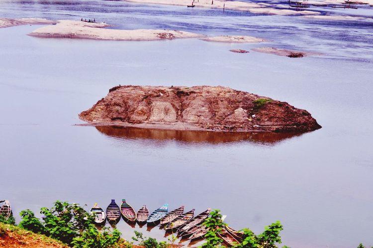 Moored Rowboats At Beach By Rock