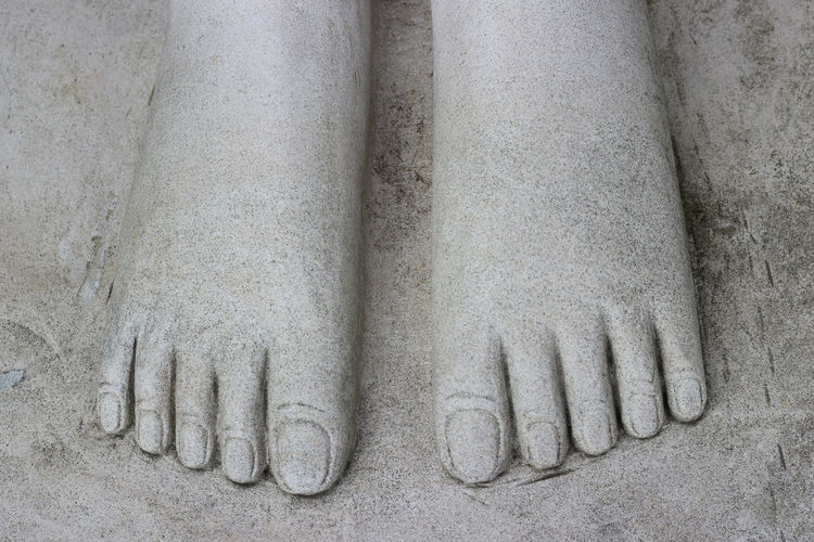 Foot statue of an ancient place No People Close-up Sculpture Human Representation Gray Art And Craft Craft History Side By Side Male Likeness Stone Material The Past Architecture Statue Solid Representation In A Row Carving - Craft Product Wall - Building Feature Bas Relief Silver Colored Concrete