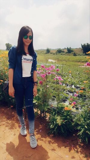 One Person Standing Real People Front View Young Adult Young Women Casual Clothing Full Length Lifestyles Outdoors Nature Sky Day Tree Flower Bynote5 ทุ่งกังหันลม 🍃⛰🌱😊