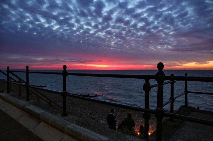 Beach party Herne Bay Style Dramatic Sky Sunset Railings Friends Fire Beach Party Water Sky Sea Scenics - Nature Beauty In Nature Railing Sunset Nature Night Beach Cloud - Sky Tranquil Scene Land Astronomy Tranquility Silhouette Architecture Horizon Over Water Outdoors