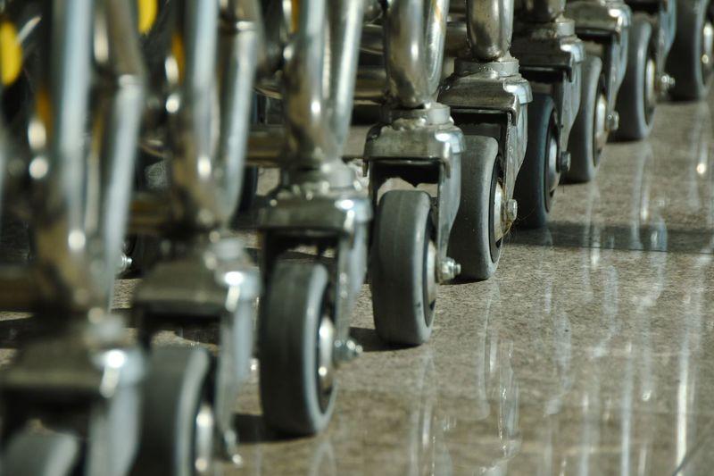 Push cart wheels in row tiled floor