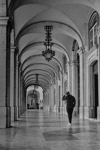 Man walking in corridor of building