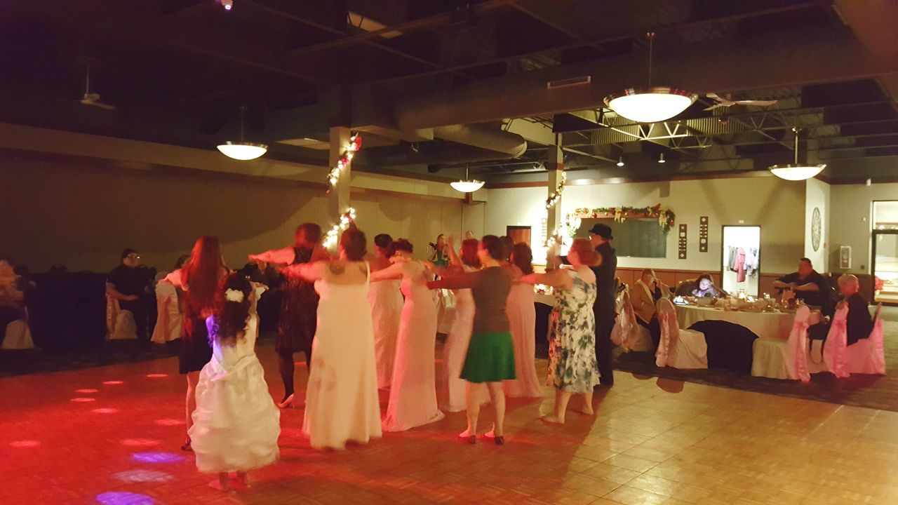 indoors, large group of people, fashion, bride, real people, illuminated, wedding dress, togetherness, men, women, full length, day, people