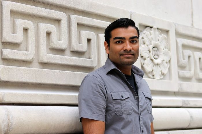 Young handsome man standing by marble exterior of building American Architecture Book Building Exterior Bussiness College Day Grey Handsome Happy Indian Male Man Marble One Person Outdoors Portrait Portrait Photography Smart Student Wealthy Young Adult
