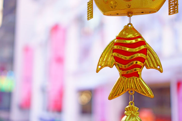 Close-up of multi colored decoration hanging outside temple