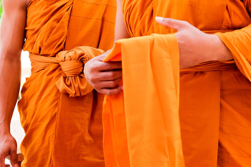 Yellow robe of Buddhist monks, Closeup on buddhist monk Buddhist Buddhist Temple In Thailand Religion And Tradition Religious Art Buddhist Culture Buddhist Monks Buddhist Temple Clothing Group Of People Human Body Part Lifestyles Men Midsection Monk  Monks Orange Orange Color People Real People Religion Religion And Beliefs Religious  Robe Traditional Clothing Yellow Robe