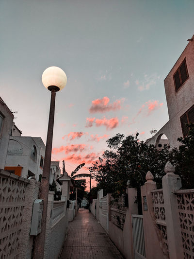 an evening in Torrevieja Residential District Streetlights Pedestrian Walkway Pedestrian Street Twilight Twilight Sky City Sky Architecture Residential Structure Sunset Evening Orange Color Dramatic Sky Scenics Tranquil Scene Idyllic Settlement Cloud - Sky Silhouette Building Exterior