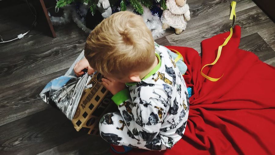 New year happy kid's /желанное начало года 🎁 Gift Box Christmastime Chaildhood EyeEm Selects My Favorite Photo Valysh_Tina People Of EyeEm EyeEm Gallery Blond Hair Child Childhood Full Length Lying Down High Angle View Baby Clothing One Baby Boy Only Moms & Dads