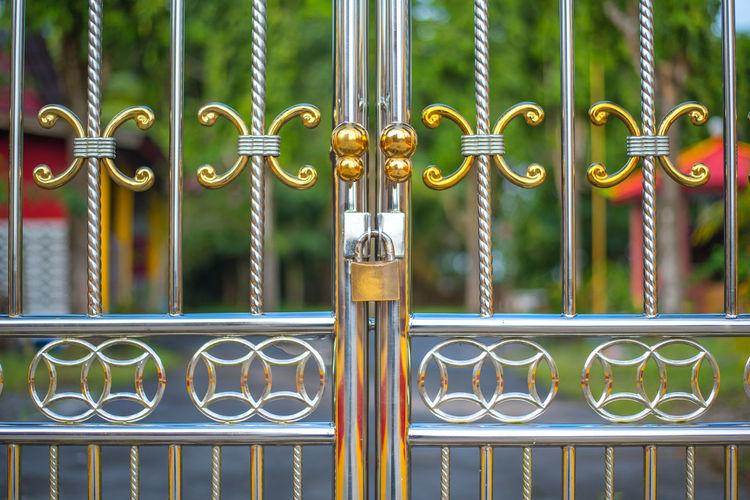 Close-Up Of Padlock On Steel Gate